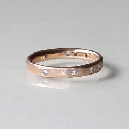 Handmade rose gold wedding band with diamonds